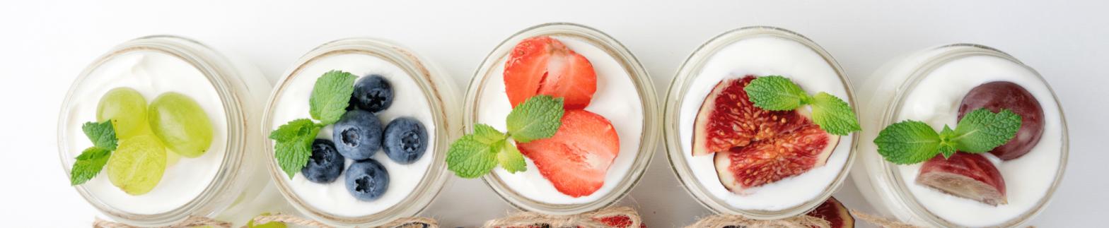 Five jars of yogurt with fruit