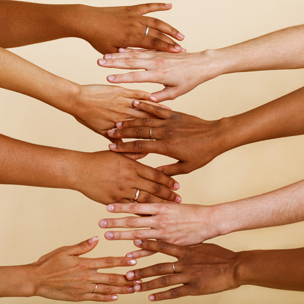 Many hands showing diverse skin tones